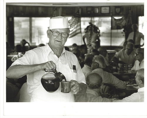 Image for Galveston, Texas Photograph: The Restaurateur Pouring Coffee